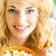 Cheerful woman eating cereal muslin — Stock Photo #20031751