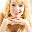 Smiling young beautiful woman, indoors — Stock Photo #20031769