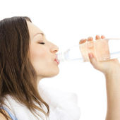 Young woman with water, on white — Stock Photo