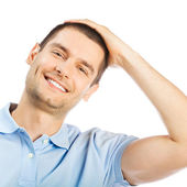 Cheerful thinking young man, over white — Stock Photo