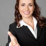 Businesswoman giving hand for handshake — Stock Photo