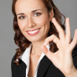 Young businesswoman showing okay gesture — Stock Photo #20107539