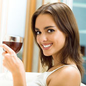 Young woman with glass of redwine — Stock Photo