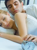 Happy couple waking up together — Stock Photo