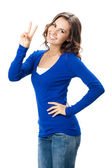 Woman showing two fingers or victory gesture, on white — Photo