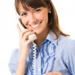 Young happy smiling business woman with plastic card, on phone — Stock Photo #21246079