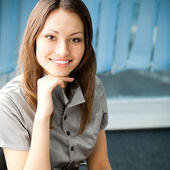 Young cheerful smiling businesswoman — Stock Photo