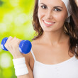 Woman exercising with dumbbell, outdoors — Stock Photo #21300649