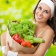 Foto Stock: Womin fitness wear with vegetarifood