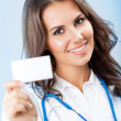 Young female doctor showing blank business card — Stock Photo #21702179