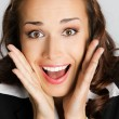 Surprised businesswoman, on gray - Foto Stock