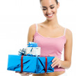 Young smiling woman with gift, isolated  — Стоковая фотография