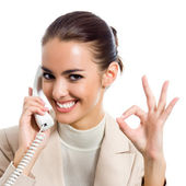 Businesswoman with phone showing okay sign — Stock Photo