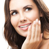 Woman touching skin or applying cream, isolated — Stock Photo