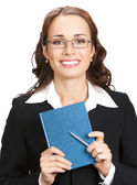 Young businesswoman with notepad, isolated — Stock Photo
