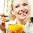 Cheerful woman eating cereal muslin  — Stock Photo #22767126