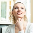 Young smiling blond woman thinking — Stock Photo #22767216