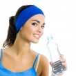 Woman in fitness wear with water, over white — Stock Photo