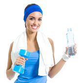 Woman with dumbbell and water, isolated — Stock Photo