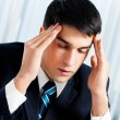 Thinking, tired or ill with headache businessman - Stock Photo