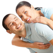 快乐微笑的年轻夫妇,在白色 — 图库照片