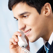 Portrait of young smiling businessman or call center worker — Stock Photo