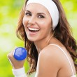Woman exercising with dumbbell, outdoors — Stock Photo #23216140
