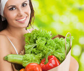 Woman in fitness wear with vegetarian food — Стоковое фото