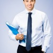 Business man with folder, on violet — Stock Photo