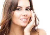 女人接触皮肤或应用霜隔离 — 图库照片