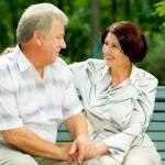 Senior happy couple embracing, outdoors — Stock Photo