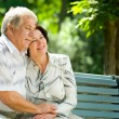 Senior couple in headset together, outdoors — ストック写真