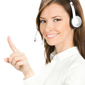 Customer support phone operator in headset pointing — Stock Photo