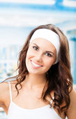 Portrait of young smiling woman at fitness club — Stock Photo