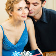 Cheerful amorous couple with gifts, indoors — Stock Photo #24327825