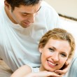 Cheerful smiling young couple, indoors - Stock Photo