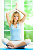 Blond woman meditating, indoors — Stock Photo
