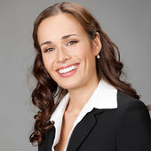 Smiling businesswoman, over gray — Stock Photo