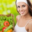Woman in fitness wear with vegetarian food — Stock Photo #24384295