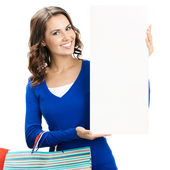 Woman with shopping bags and signboard, isolated — Stock Photo
