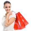 Young happy woman with shopping bags, isolated — Stock Photo #25017701