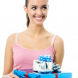 Young smiling woman with gift, isolated  — Stock Photo