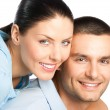 Portrait of young happy smiling attractive couple, isolated on w — Stock Photo #25214757