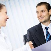 Two happy businesspeople handshaking — Stock Photo