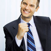 Happy successful gesturing businessman — Stock Photo