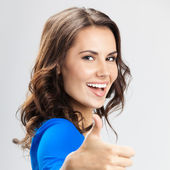 Young woman with thumbs up gesture, over grey — Foto de Stock