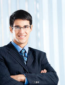 Happy smiling businessman at office — Stock Photo