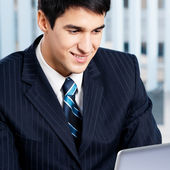 Businessman working with laptop at office — Foto de Stock