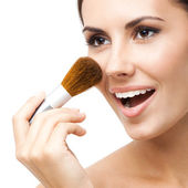 Young woman with cosmetics brush, isolated — Stock Photo