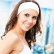 Young smiling woman at fitness club — Stok fotoğraf